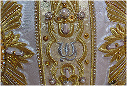 a close shot of the Pope's monogram